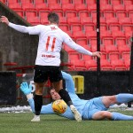 Ally Love tries to get the ball past away 'keeper Calum Ferrie.