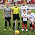 The match mascots line-up with the captains before kick-off.