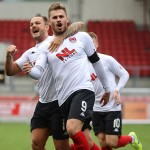 Goodwillie celebrates in front of the Main Stand after making it 2-0.